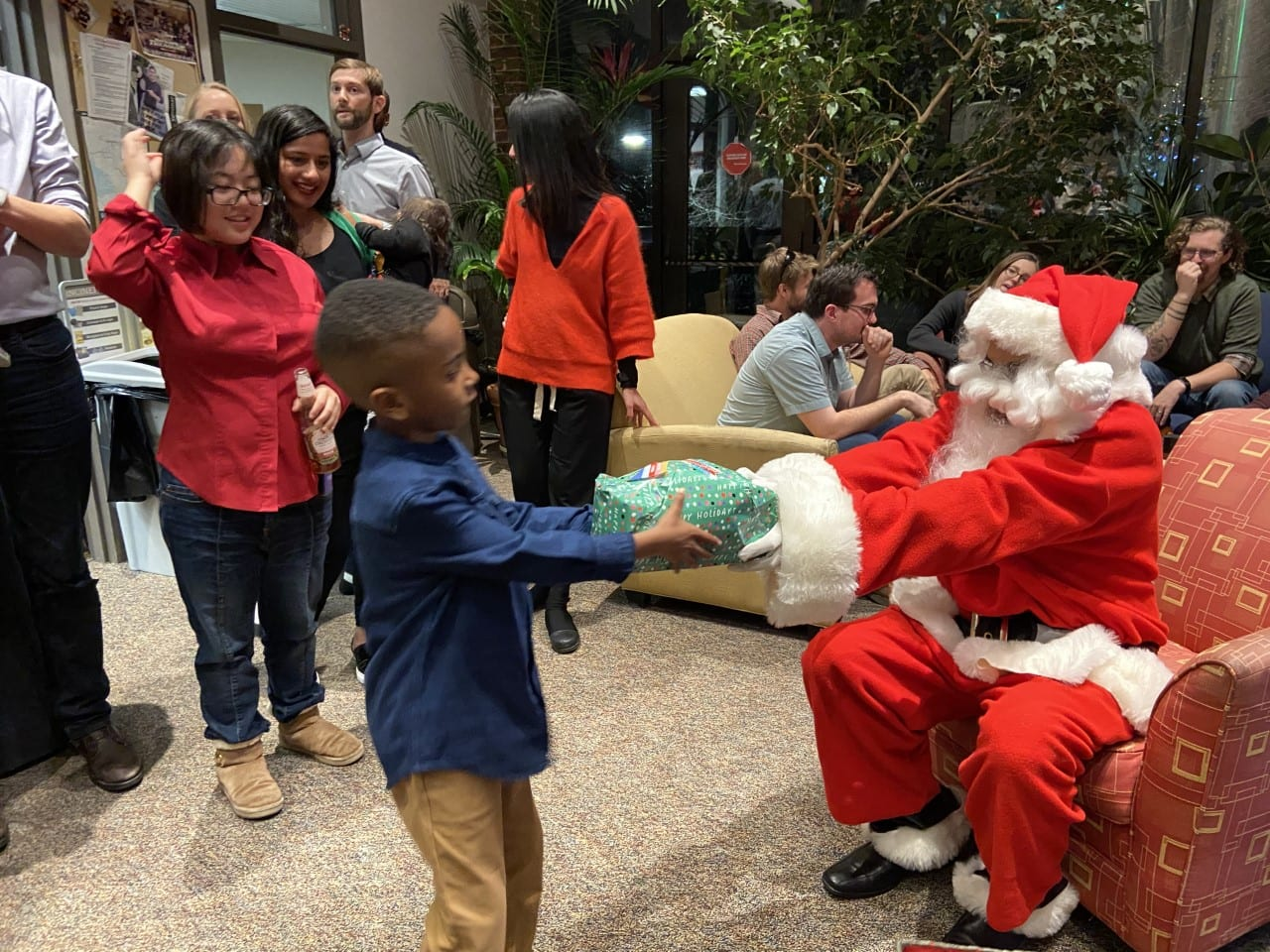 Santa hands out presents at the EPS holiday party